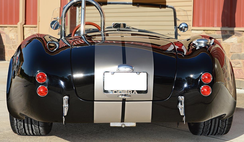 aerial rear-quarter shot (driver side) of Onyx Black Backdraft Racing 427SC Shelby classic Cobra replica for sale, BDR752