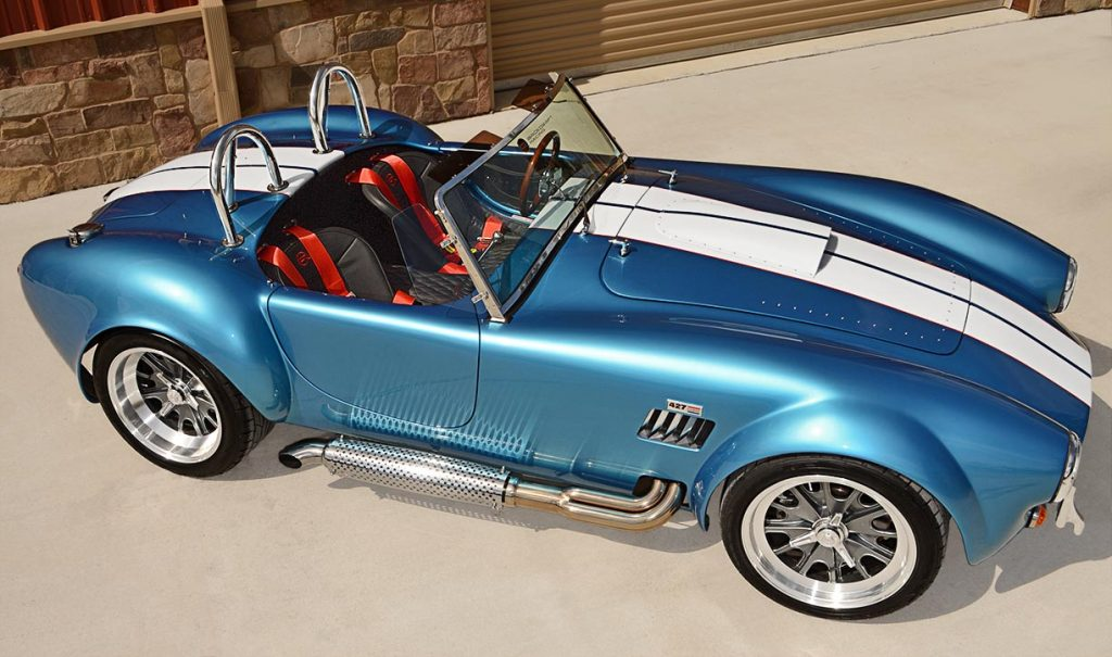 elevated broadside shot (passenger side) of Electric Blue Backdraft Racing replica of Shelby classsic 427SC Cobra for sale, BDR1755