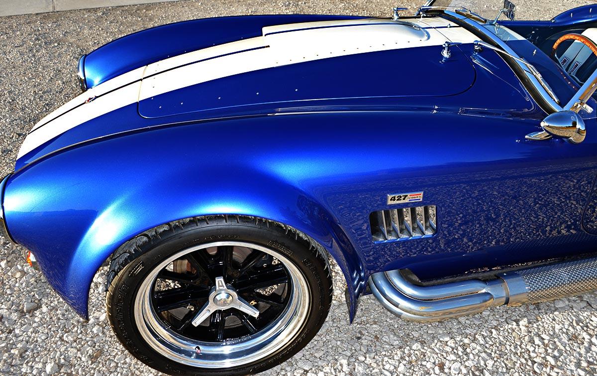 front-quarter shot (driver side) shot of deep Royal Blue/Arctic White LeMans stripes Superformance 427SC Shelby classic Cobra replica for sale, SP02499