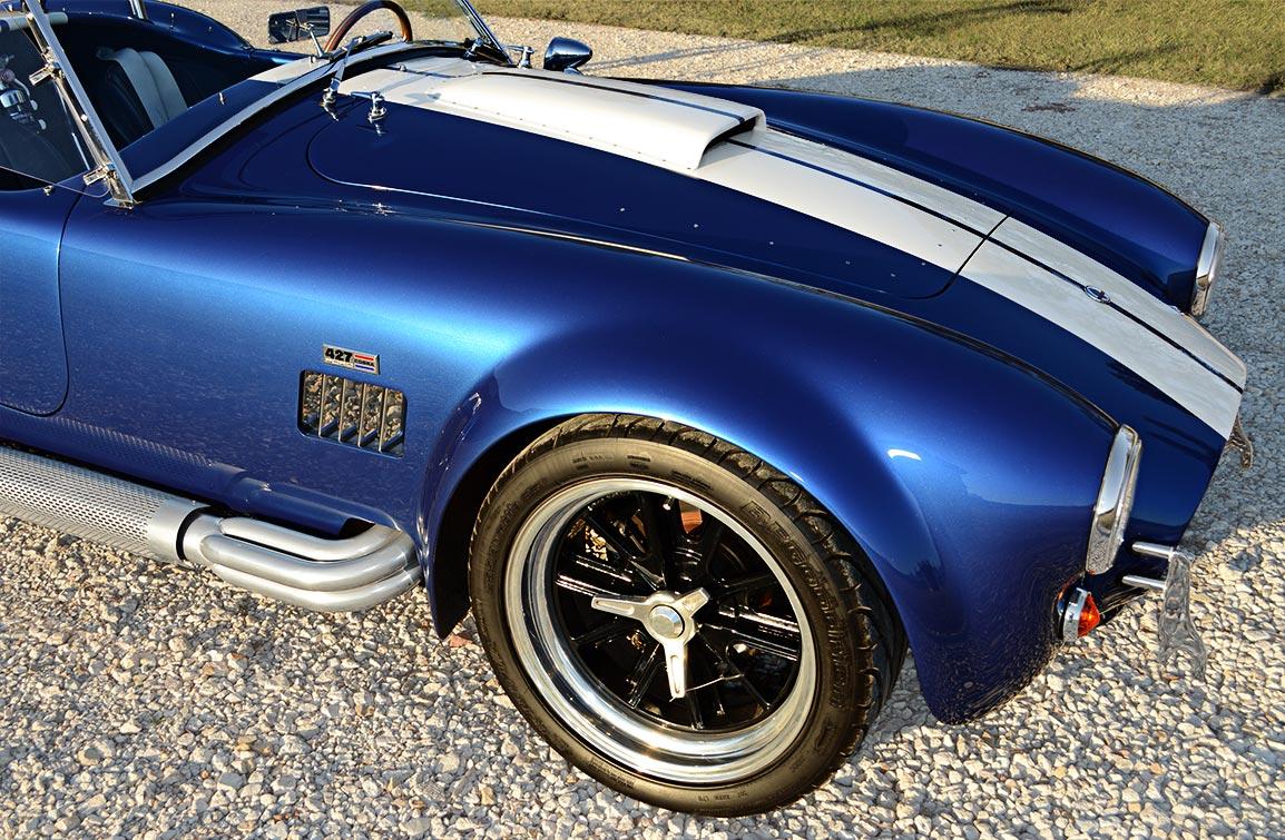 front-quarter shot (passenger side) shot of deep Royal Blue/Arctic White LeMans stripes Superformance 427SC Shelby classic Cobra replica for sale, SP02499