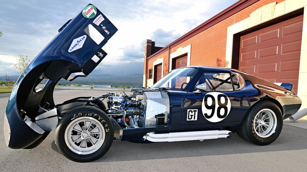 broadside shot (with engine deck up) of Indigo Blue Factory Five Racing Type 65 Daytona Coupe for sale by owner