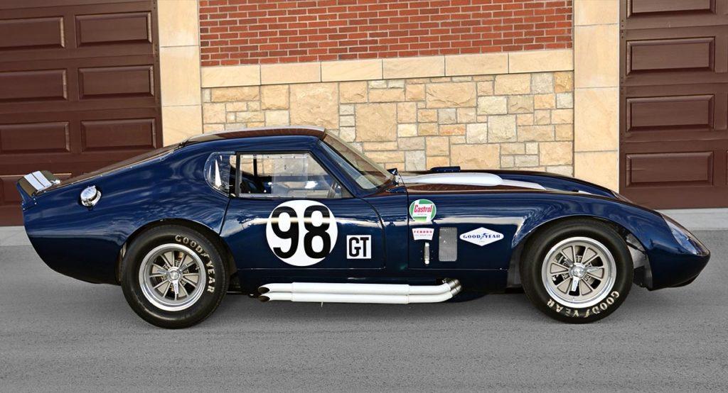 broadside shot (passenger side) of Indigo Blue Factory Five Racing Type 65 Daytona Coupe for sale by owner