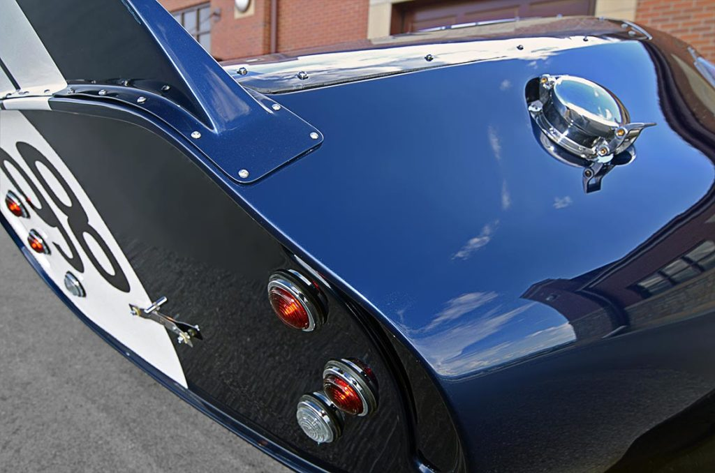 rear-quarter closeup shot (passenger side) of Indigo Blue Factory Five Racing Type 65 Daytona Coupe for sale by owner