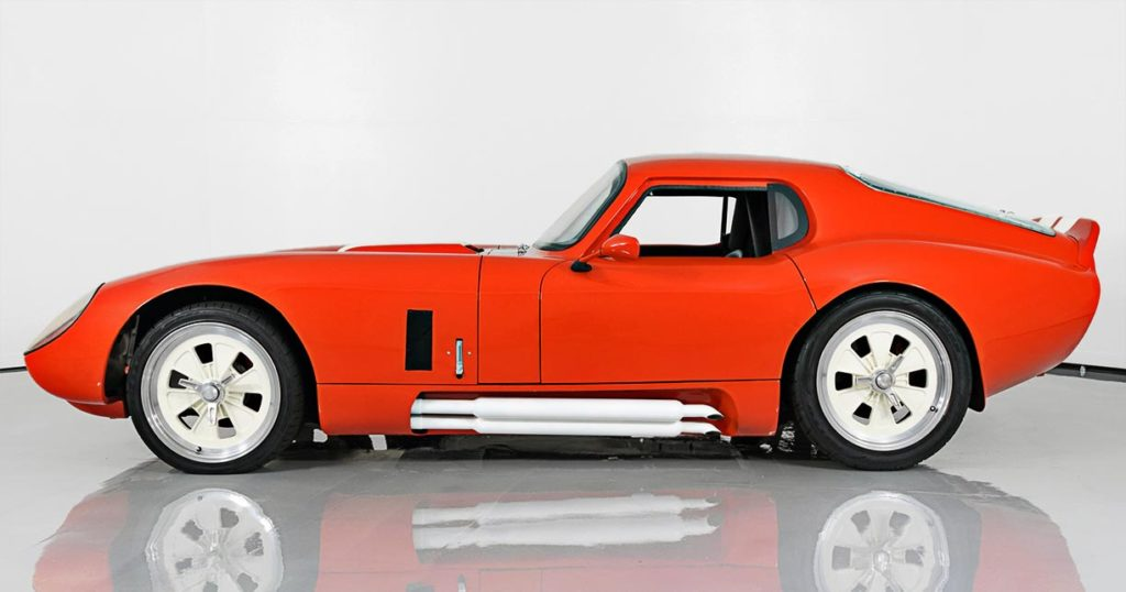 broadside shot (driver side) of this Poppy Red Shelby Daytona Coupe replica by JBL Motorsports, for sale by owner.