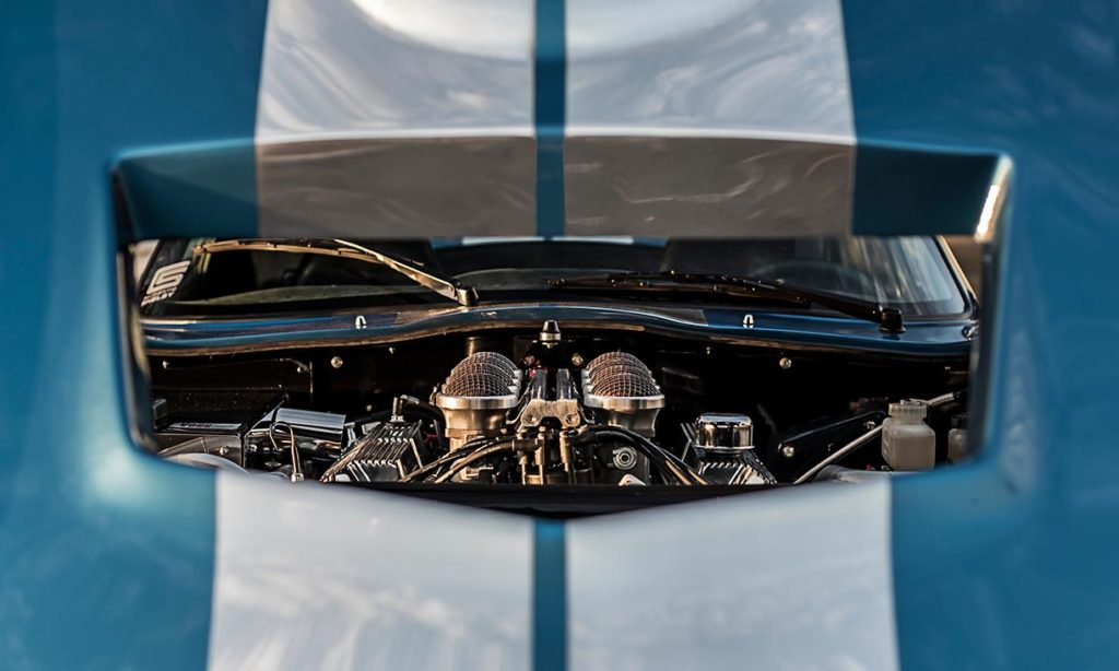peekaboo shot of engine through the hood scoop of Guardsman Blue Shelby Cobra Daytona Coupe for sale, SPC9011