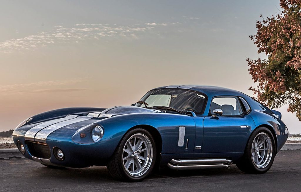 driver-side 3/4-frontal California sunset shot of Guardsman Blue Shelby Cobra Daytona Coupe for sale on this page, SPC9011