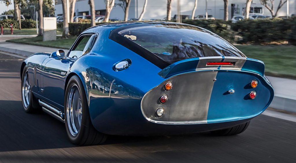 "3/4-rear ""adios"" shot (driver side, at speed) of Guardsman Blue Shelby Cobra Daytona Coupe for sale on this page, SPC9011"