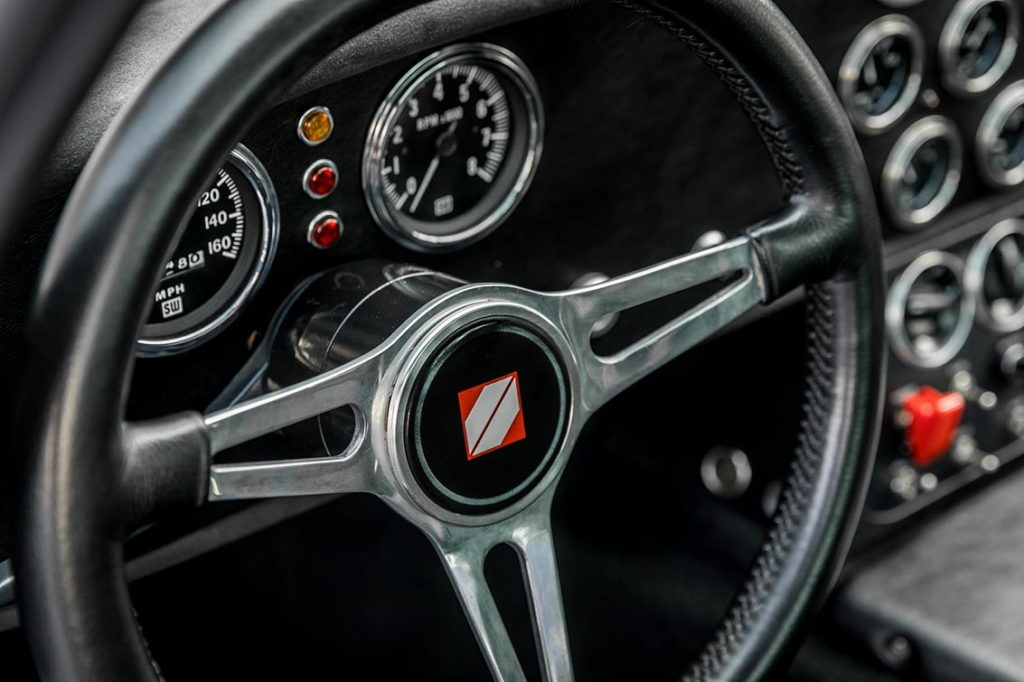 leather-wrapped steering & gauges shot of Guardsman Blue Superformance classic Shelby Daytona Cobra Coupe for sale, SPC0006 (Hillbank showroom)
