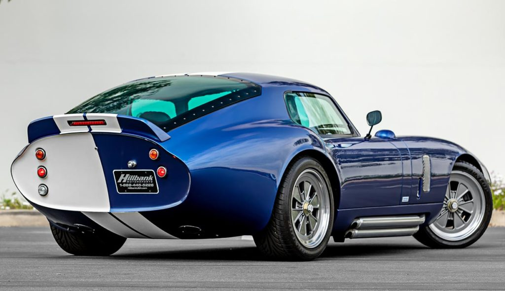 3/4-rear (passenger side) shot of Guardsman Blue Superformance classic Shelby Daytona Cobra Coupe for sale, SPC0006 (Hillbank showroom)