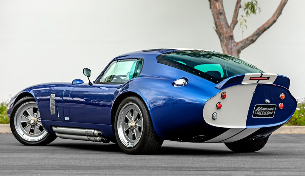 3/4-rear (driver side) shot of Guardsman Blue Superformance classic Shelby Daytona Cobra Coupe for sale, SPC0006 (Hillbank showroom)