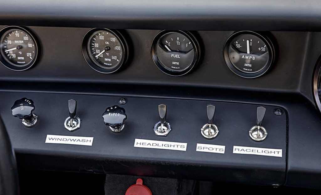 closeup of dashboard gauges & switches of Gulf Blue Superformance Ford GT40 Mk1 for sale, P2141