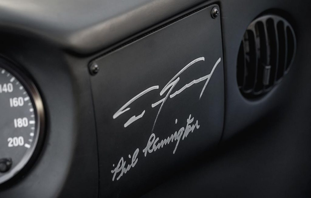 closeup shot of personal autographs of Dan Gurney and Phil Remington, on the dashboard of Gulf Blue Superformance Ford GT40 Mk1 for sale, P2141
